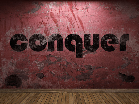 conquer: conquer word on red wall