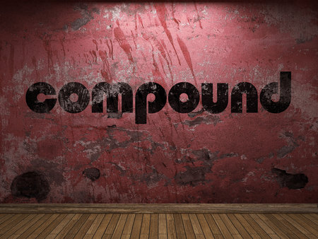 compound: compound word on red wall Stock Photo