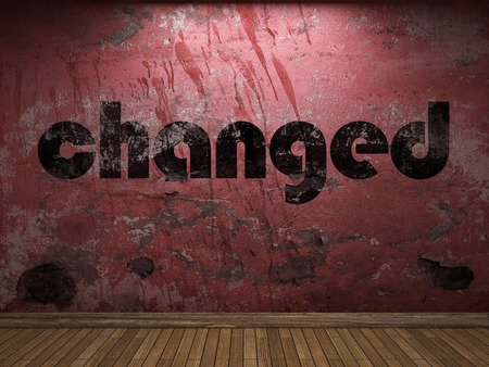 changed: changed word on red wall Stock Photo