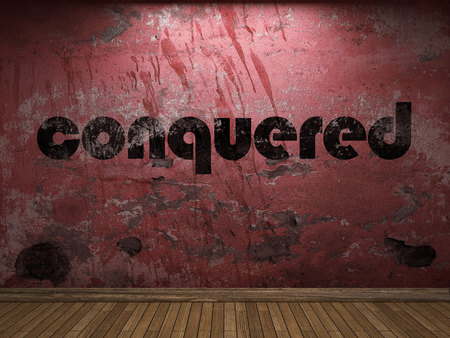 conquered: conquered word on red wall Stock Photo