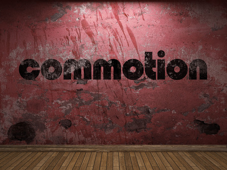 commotion: commotion word on red wall
