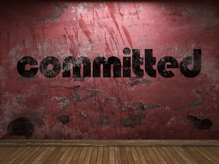 committed: committed word on red wall