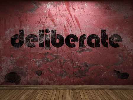 deliberate: deliberate word on red wall