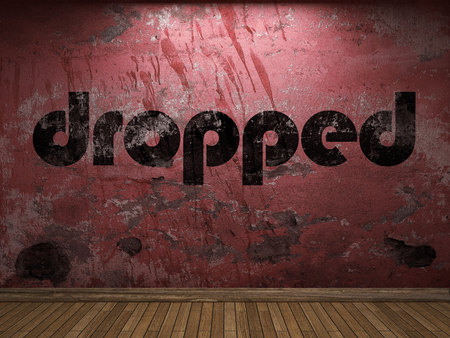 dropped: dropped word on red wall Stock Photo