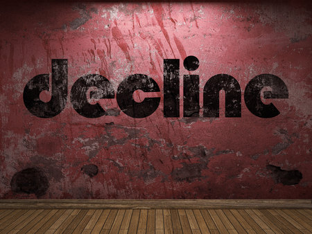the decline: decline word on red wall Stock Photo
