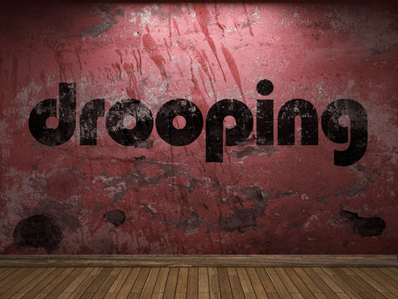 drooping: drooping word on red wall Stock Photo