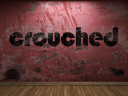 crouched: crouched word on red wall Stock Photo