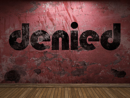 denied: denied word on red wall