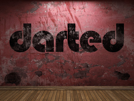 darted word on red wall