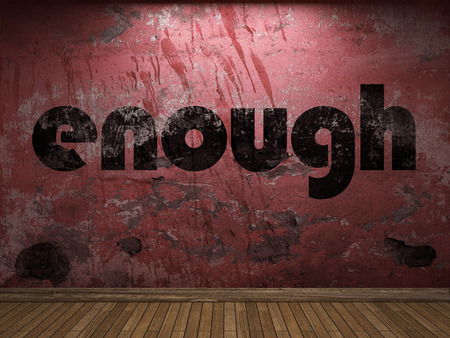 enough: enough word on red wall Stock Photo