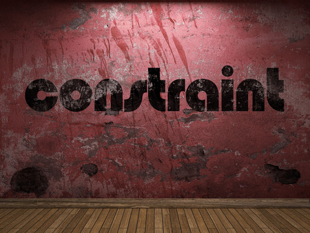 constraint: constraint word on red wall Stock Photo