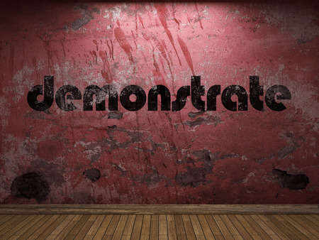 demonstrate: demonstrate word on red wall Stock Photo
