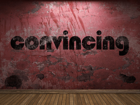 convincing: convincing word on red wall Stock Photo