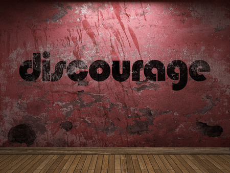 discourage: discourage word on red wall