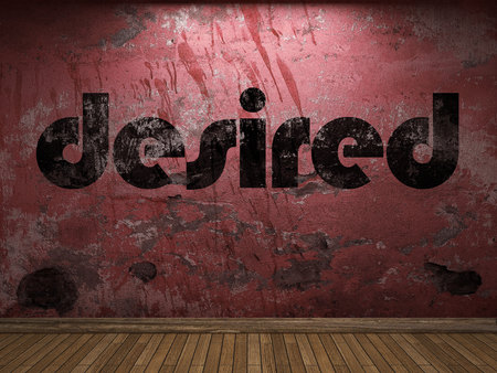 desired: desired word on red wall Stock Photo