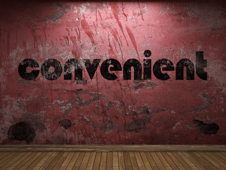 the convenient: convenient word on red wall Stock Photo