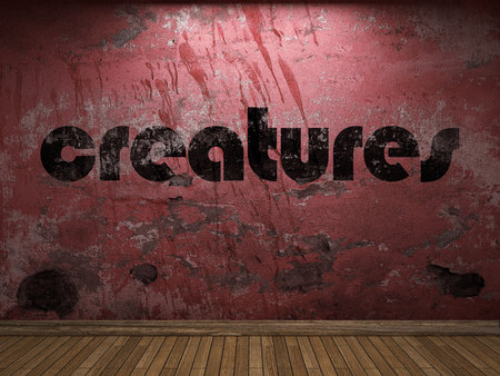 creatures: creatures word on red wall