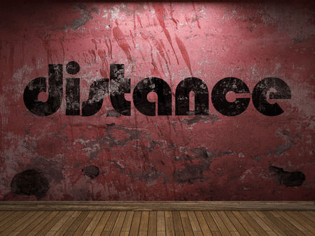 the distance: distance word on red wall Stock Photo