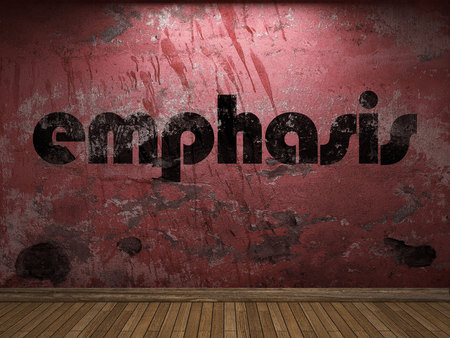 emphasis: emphasis word on red wall Stock Photo