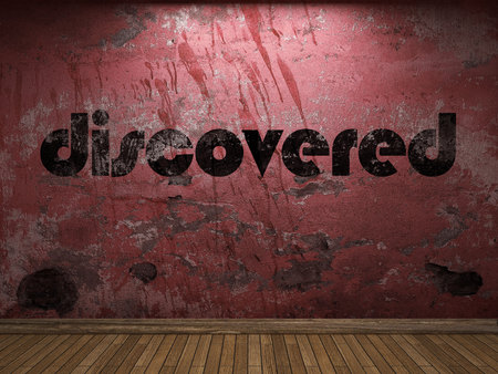 discovered: discovered word on red wall