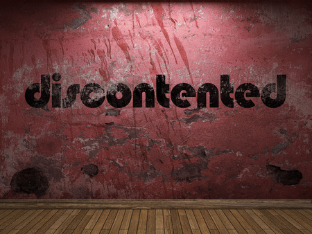 discontented: discontented word on red wall Stock Photo