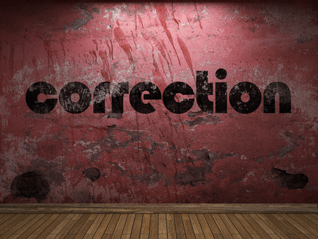 correction: correction word on red wall