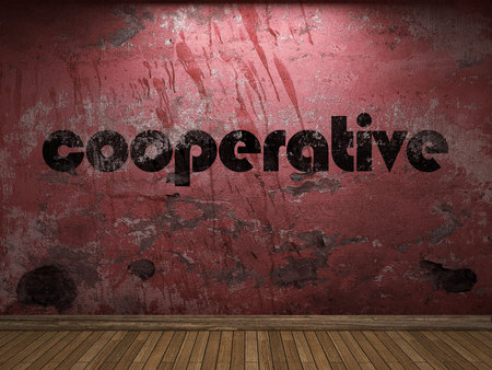 cooperativismo: palabra de cooperación en la pared roja