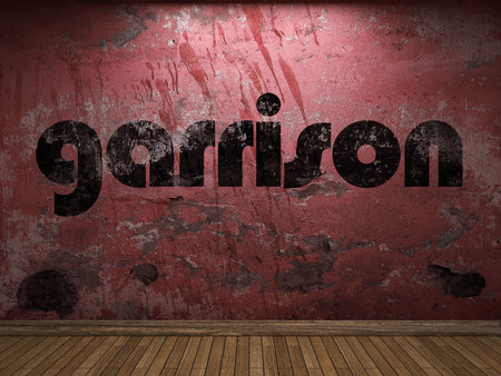 garrison: garrison word on red wall Stock Photo