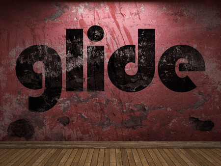 glide: glide word on red wall Stock Photo