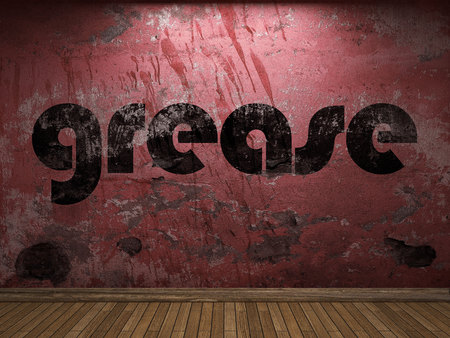 grease: grease word on red wall Stock Photo