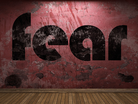 fear: fear word on red wall