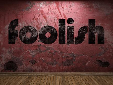 foolish: foolish word on red wall
