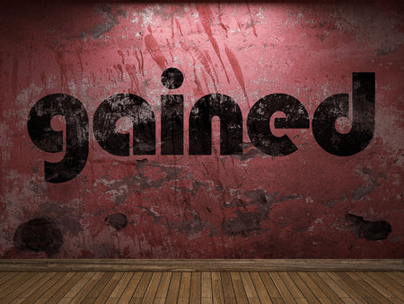gained: gained word on red wall Stock Photo