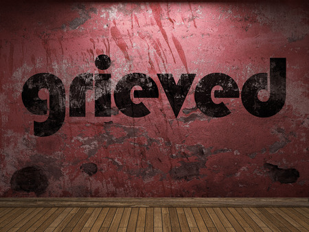 grieved: grieved word on red wall