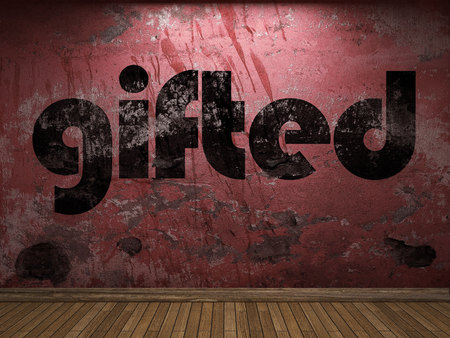 gifted: gifted word on red wall Stock Photo