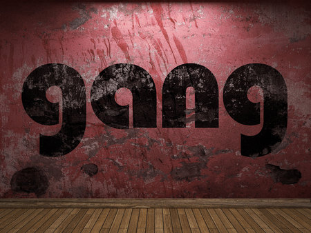 gang: palabra pandillas en la pared roja