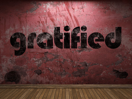 gratified: gratified word on red wall
