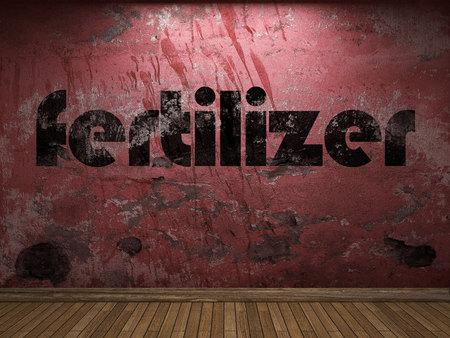 fertilizer: fertilizer word on red wall Stock Photo