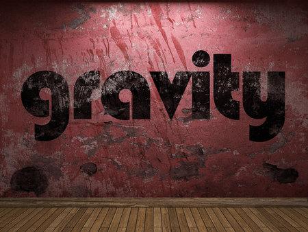 palabra gravedad en la pared roja Foto de archivo