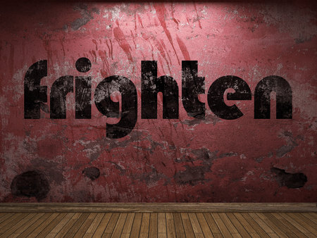 frighten: frighten word on red wall Stock Photo