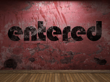 entered: entered word on red wall Stock Photo