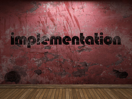implementation: implementation word on red wall