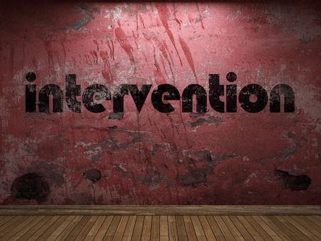 intervention: intervention word on red wall