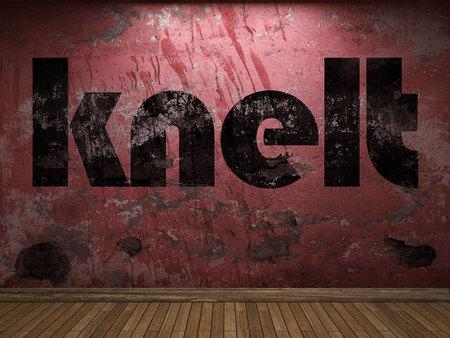 knelt: knelt word on red wall