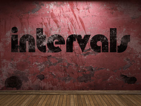 intervals: intervals word on red wall Stock Photo