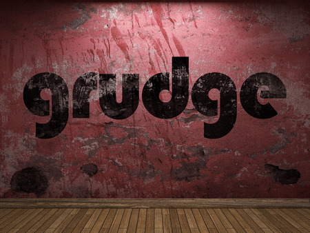 grudge: grudge word on red wall Stock Photo