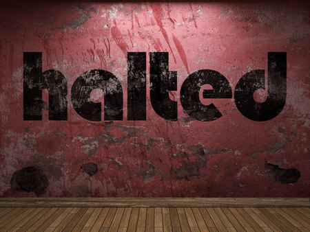 halted: halted word on red wall