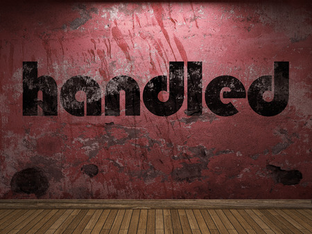 handled: handled word on red wall
