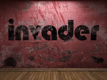 invader: invader word on red wall
