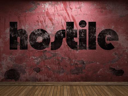 hostile: hostile word on red wall Stock Photo